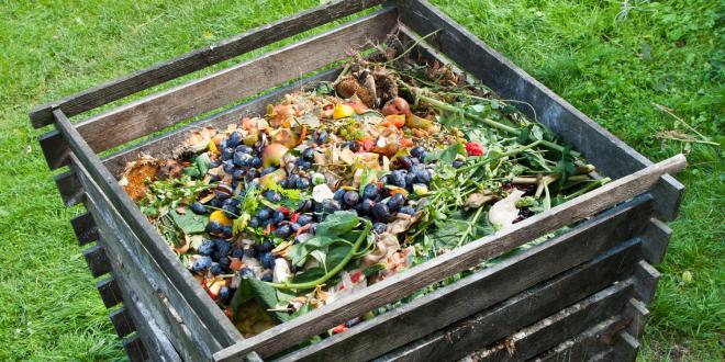 A slotted crate full of compostable materials